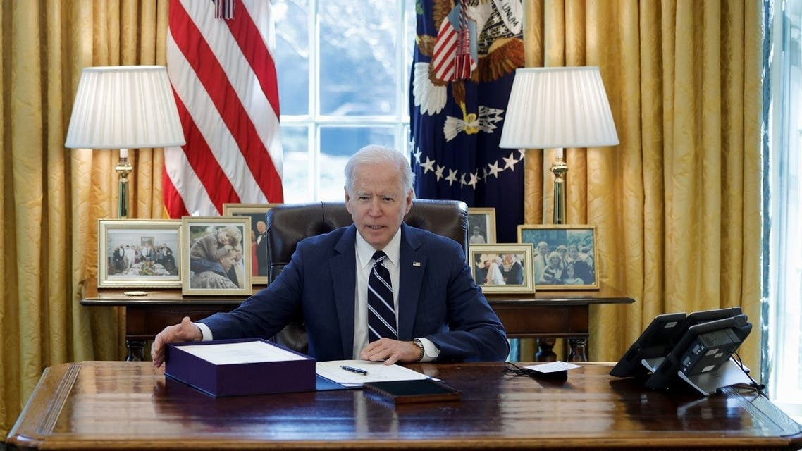 President Joe Biden looks on after signing the American Rescue Plan at the White House, March 11, 2021. (Reuters)