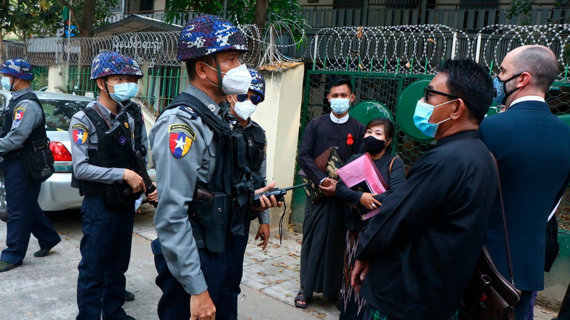 Myanmar police talk to people gathering outside the Kamayut court in Yangon, Myanmar Friday, March 12, 2021. (AP)