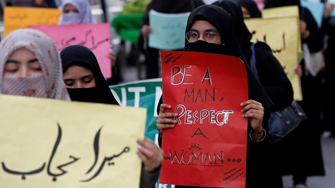Women carry signs as they take part in a march demanding equal rights, ahead of international women's day in Karachi, Pakistan March 6, 2020. (Reuters)