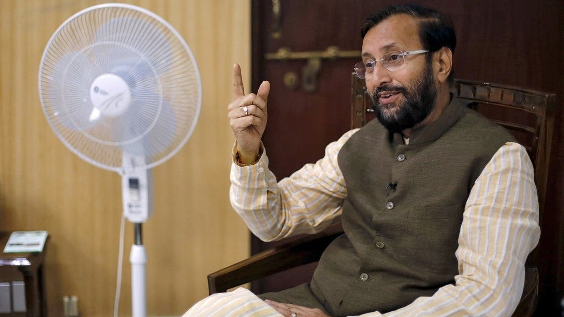 India's information and broadcasting minister Prakash Javadekar speaks on his phone before an interview with Reuters inside his office in New Delhi, India. (File photo: Reuters)