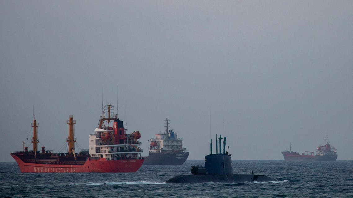 An Israeli military submarine sails past cargo ships in the Mediterranean Sea, Israel, Tuesday, Sept. 29, 2020. (AP)