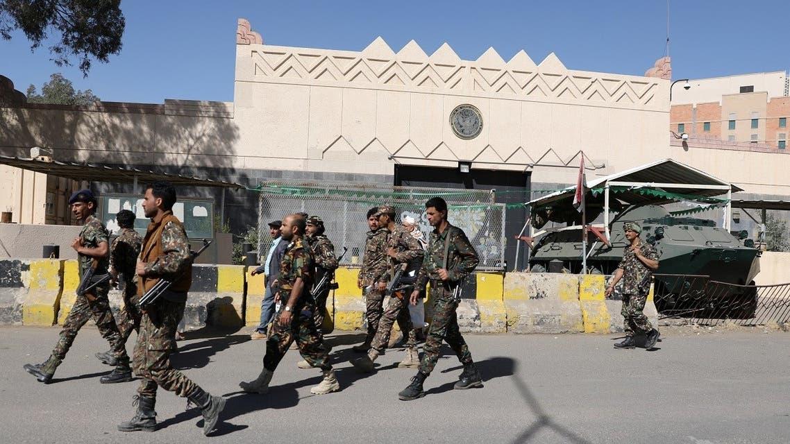 Houthi fighters walk past the US embassy's gate in Sanaa, Yemen Jan. 18, 2021. (Reuters)