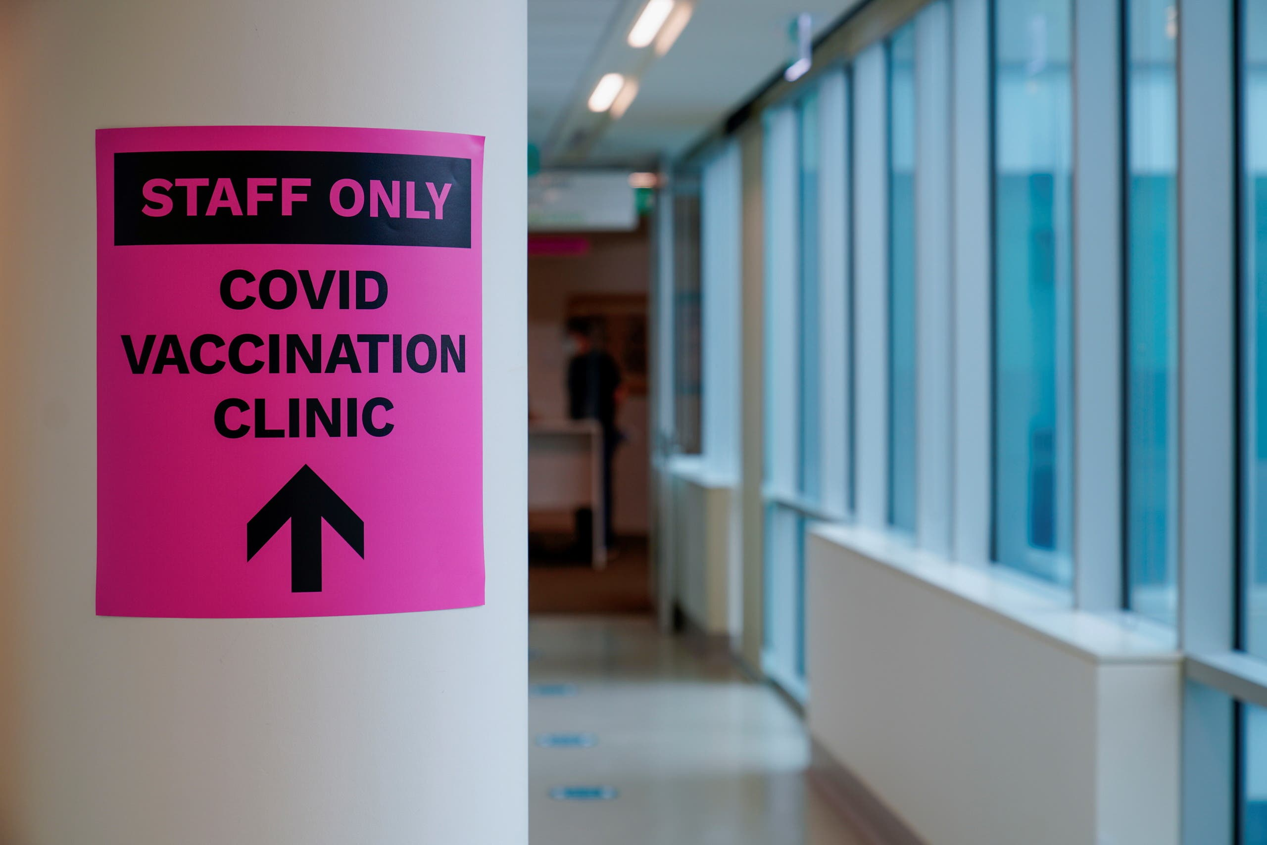 A sign for a COVID-19 vaccination clinic is seen in Melbourne. (Reuters)