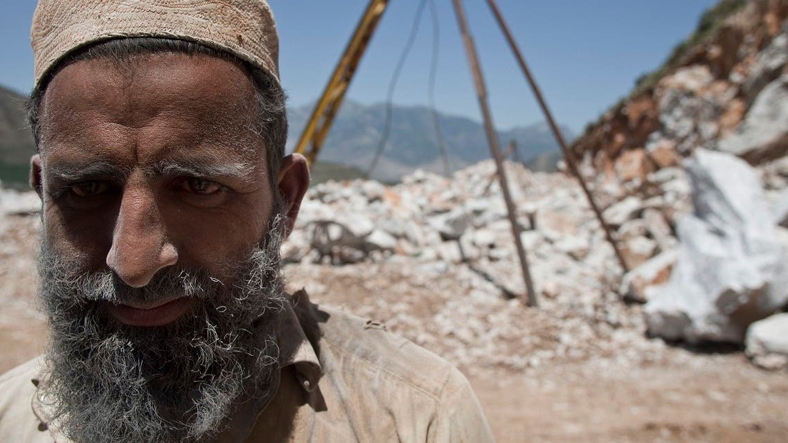 Pakistani miner Mohammad Ramzan who uses a conventional method to quarry marble and granite, stands at a site in Buner, Pakistan. (File photo: AP)
