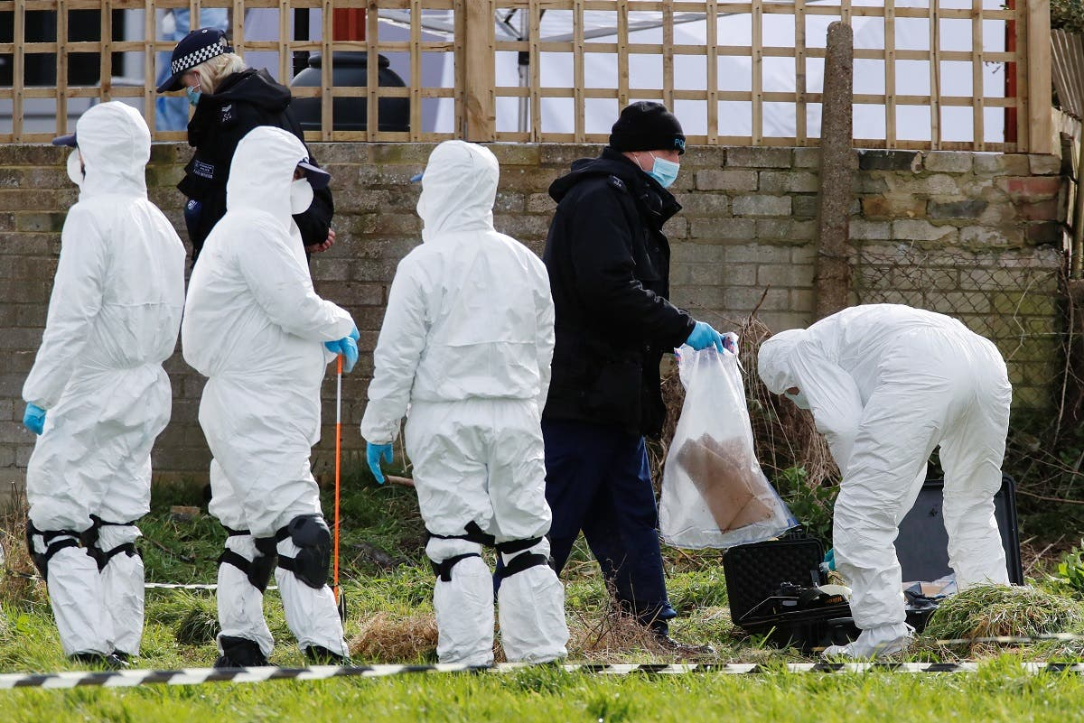 Police officers search an area of grass land behind a house, as the investigation into the disappearance of Sarah Everard continues, in Deal, Britain. (Reuters)
