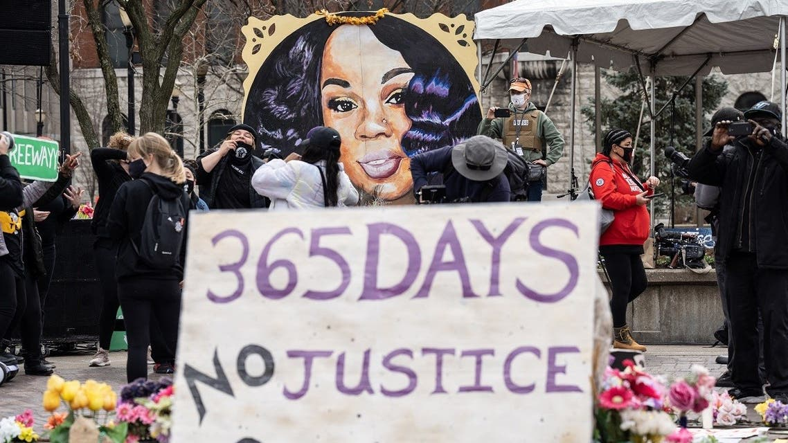A portrait of Breonna Taylor is seen in front of another protest sign during a protest memorial for her in Jefferson Square Park on March 13, 2021 in Louisville, Kentucky. (Getty Images via AFP)