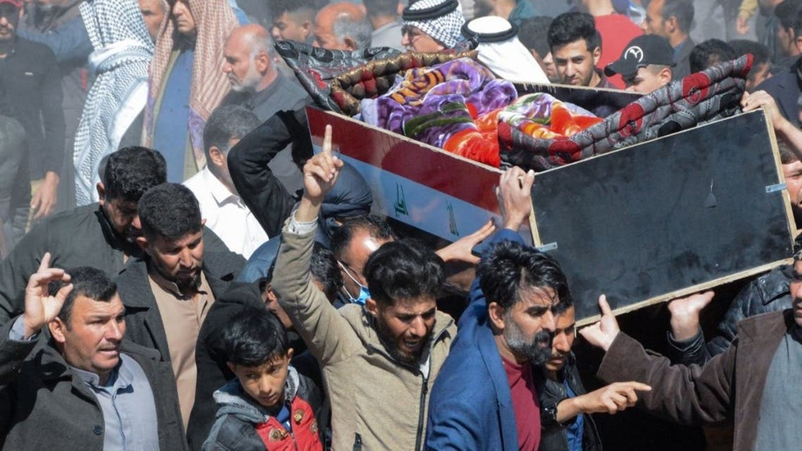 Iraqi mourners carry a coffin at the funeral of eight people killed a day earlier in attacks claimed by the Islamic State (IS) group, in the al-Bou Dor village of the Salaheddin governorate north of the capital, on March 13, 2021. An IS statement said those targeted had been spying for Hashed al-Shaabi, a Shiite-led coalition force that played a key role in 2017 in ending the jihadists' control of swathes of Iraqi territory. Mahmoud AL SAMARRAI / AFP