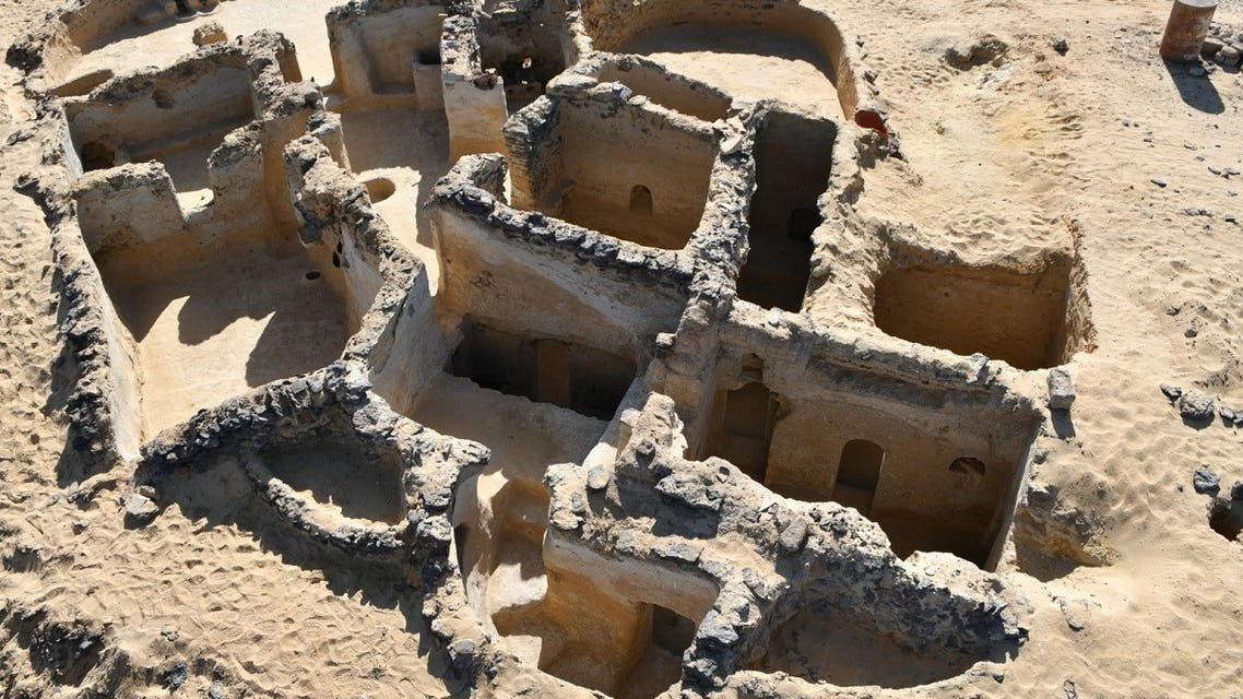 A handout picture released by the Egyptian Ministry of Tourism and Antiquities on March 13, 2021 shows a view of an ancient Christian structure carved in the bedrock dating back to the 5th century AD, discovered in the Tal Ganoub Qasr Al-Ajouz site in the Western Desert Bahariya Oasis. (AFP)