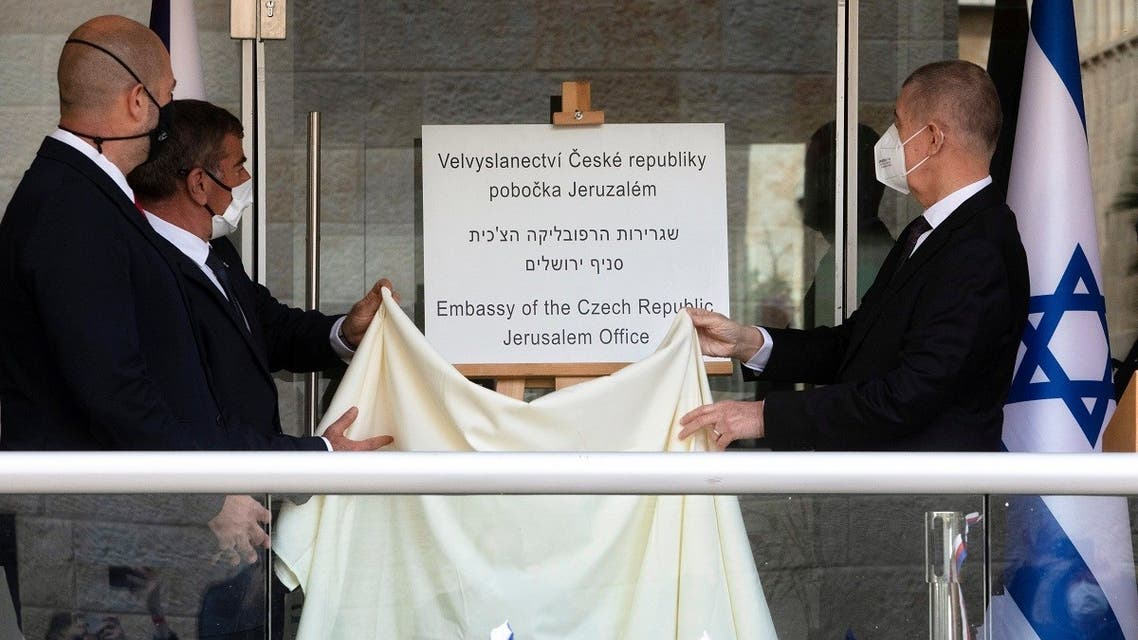 Czech PM Babis, Israeli FM Ashkenazi and Israeli Public Security Minister Amir Ohana unveil a sign during an inauguration ceremony of a Czech diplomatic representation in Jerusalem March 11, 2021. (Sebastian Scheiner/Pool via Reuters)