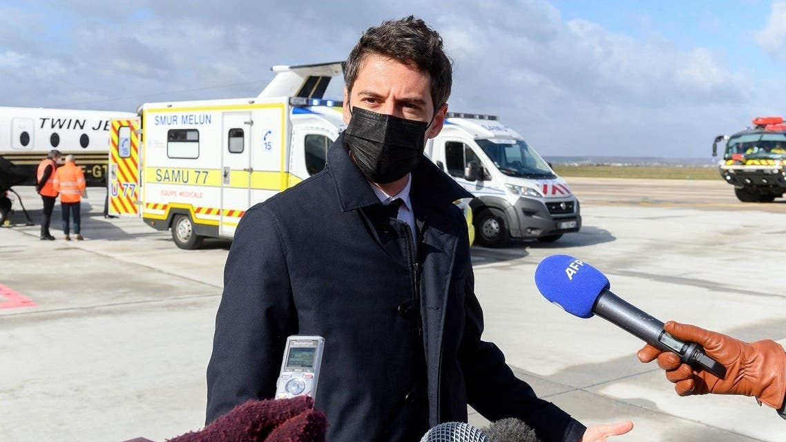 Government spokesperson Gabriel Attal answers journalists' questions after witnessing the plane transfer of two patients suffering from a severe form of COVID-19 to a hospital in Bordeaux, on March 14, 2021 in Orly. (Jacques Witt/Pool/AFP)