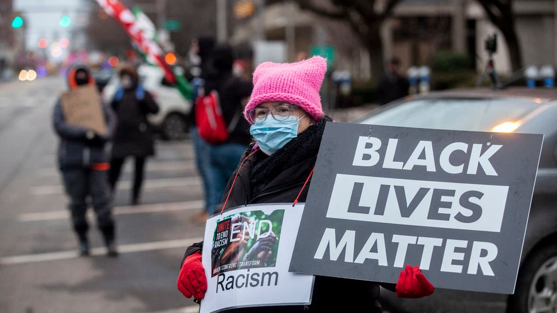 Protesters hold signs and flags during a demonstration against police brutality in front of the Fraternal Order of Police in Columbus, Ohio on December 28, 2020. (File photo: AFP)