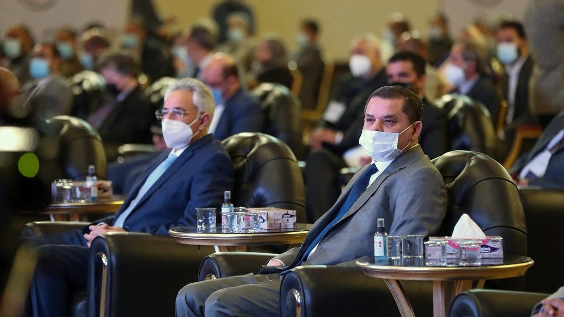 Libya's interim prime minister Abdul Hamid Dbeibah (R) attends a national conference on the COVID-19 pandemic, at a conference hall in the capital Tripoli, on March 13, 2021. (Mahmud Turkia/AFP)