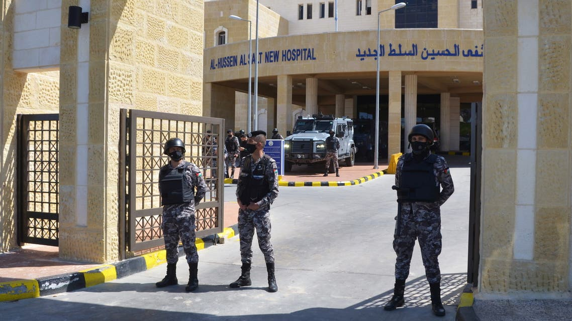 Gendarmerie officers stand guard at the gate of the new Salt government hospital in the city of Salt, Jordan March 13, 2021. (Reuters)