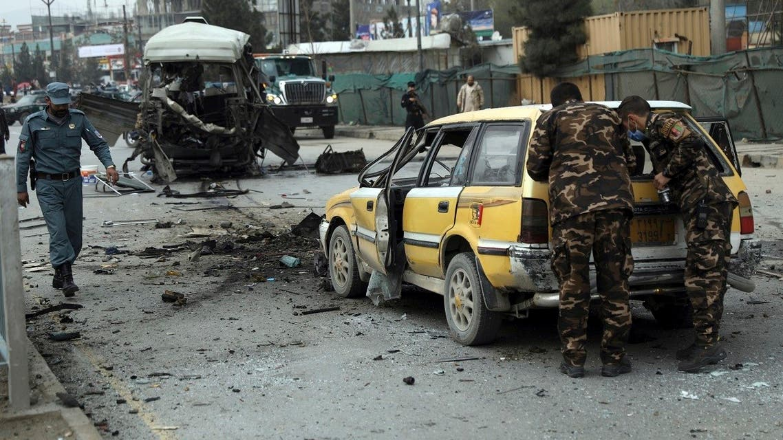 Security personnel inspect the site of a bomb attack in Kabul, Afghanistan, March 15, 2021. (AP/Rahmat Gul)