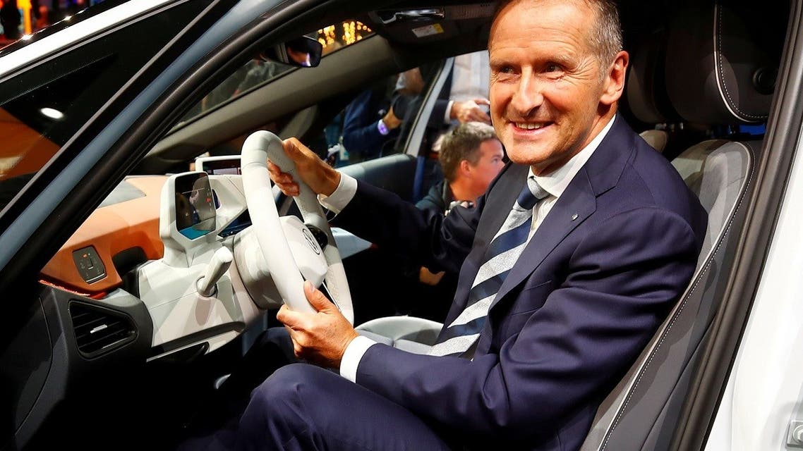 Herbert Diess, CEO of German carmaker Volkswagen AG, poses in an ID.3 pre-production prototype during the presentation of Volkswagen's new electric car on the eve of the International Frankfurt Motor Show IAA in Frankfurt, Germany, on September 9, 2019. (Reuters)