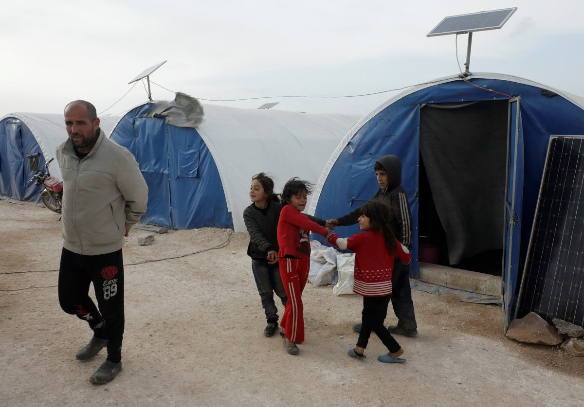 Mohammed Abu Rdan plays with his siblings at an internally displaced Syrian camp, in northern Aleppo, Syria March 11, 2021. (Reuters/Mahmoud Hassano)