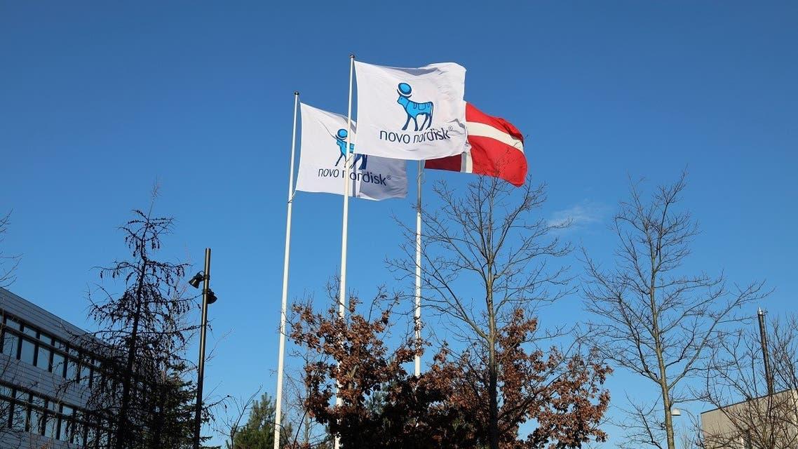 Flags are seen outside Novo Nordisk headquarters in Copenhagen, Denmark, February 5, 2020. (Reuters/Jacob Gronholt-Pedersen)