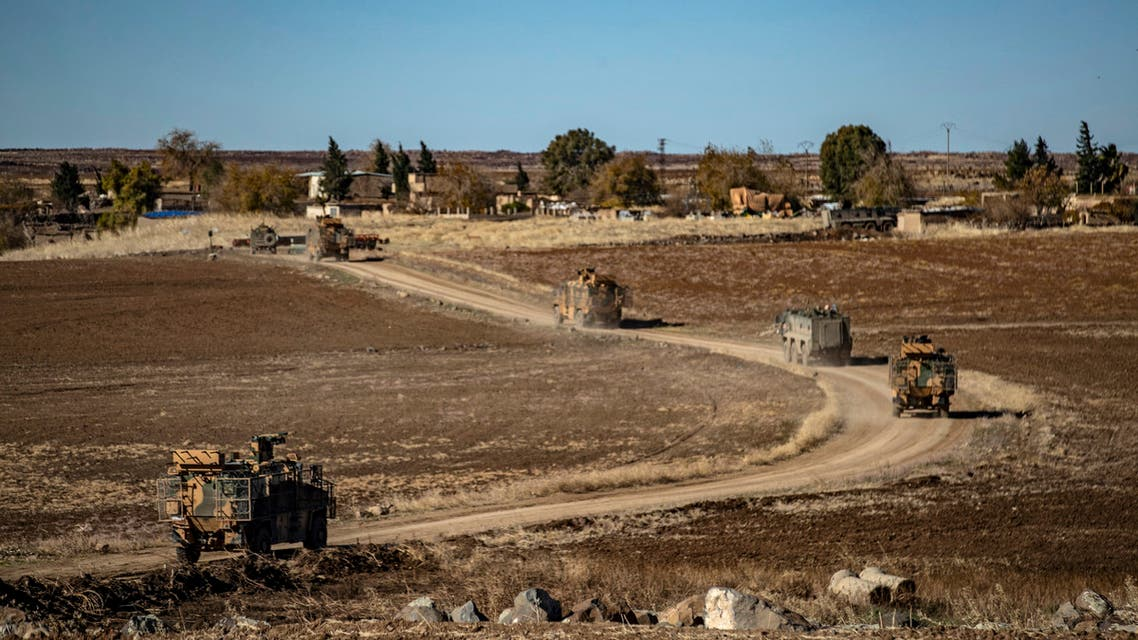 A joint Russian-Turkish patrol advances in the countryside of the Syrian town of al-Jawadiyah, in the northeastern Hasakeh province, near the border with Turkey, on December 24, 2020. (File photo: AFP)