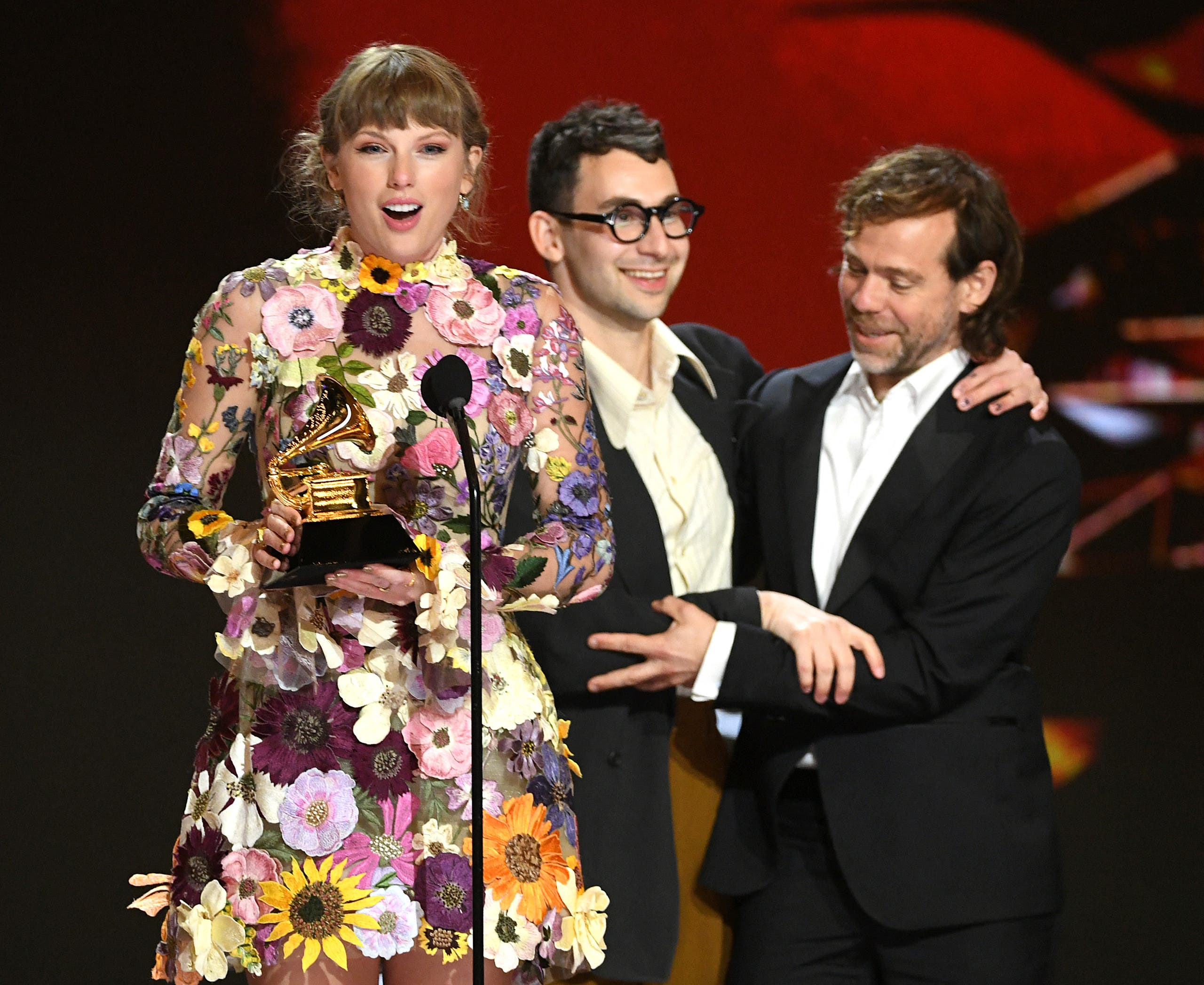 Taylor Swift, Jack Antonoff, and Aaron Dessner accept the Album of the Year award for 'Folklore' onstage during the 63rd Annual GRAMMY Awards at Los Angeles Convention Center on March 14, 2021. (File photo: AFP)