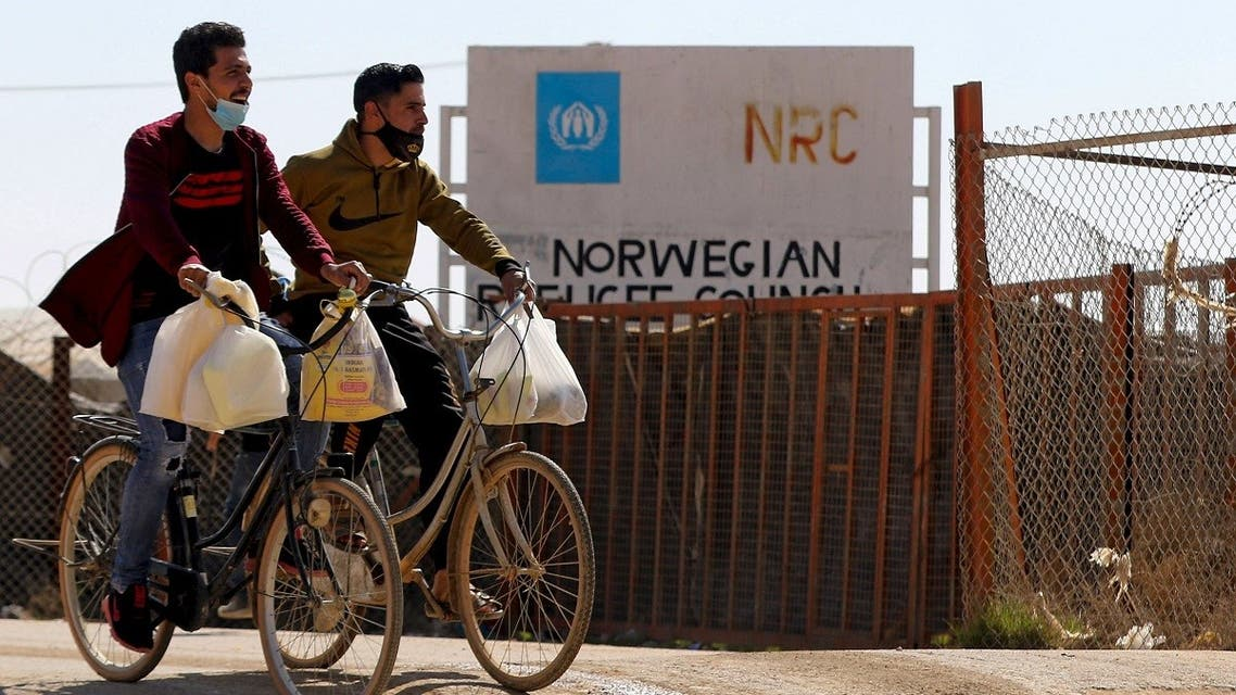 Syrian refugees ride their bicycles in the Zaatari refugee camp, 80 kilometers (50 miles) north of the Jordanian capital Amman on February 15, 2021. (Khalil Mazraawi/AFP)