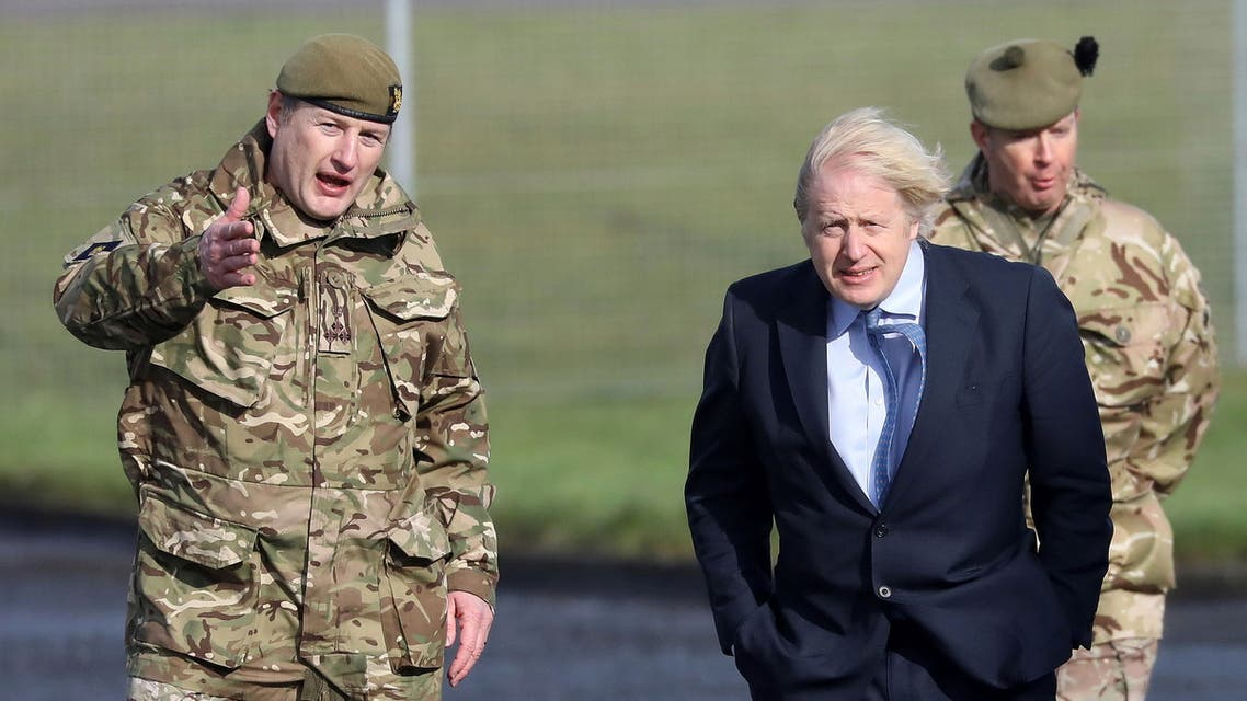 British Prime Minister Boris Johnson visits Joint Helicopter Command Flying Station Aldergrove, Northern Ireland, March, 12, 2021. (Reuters)