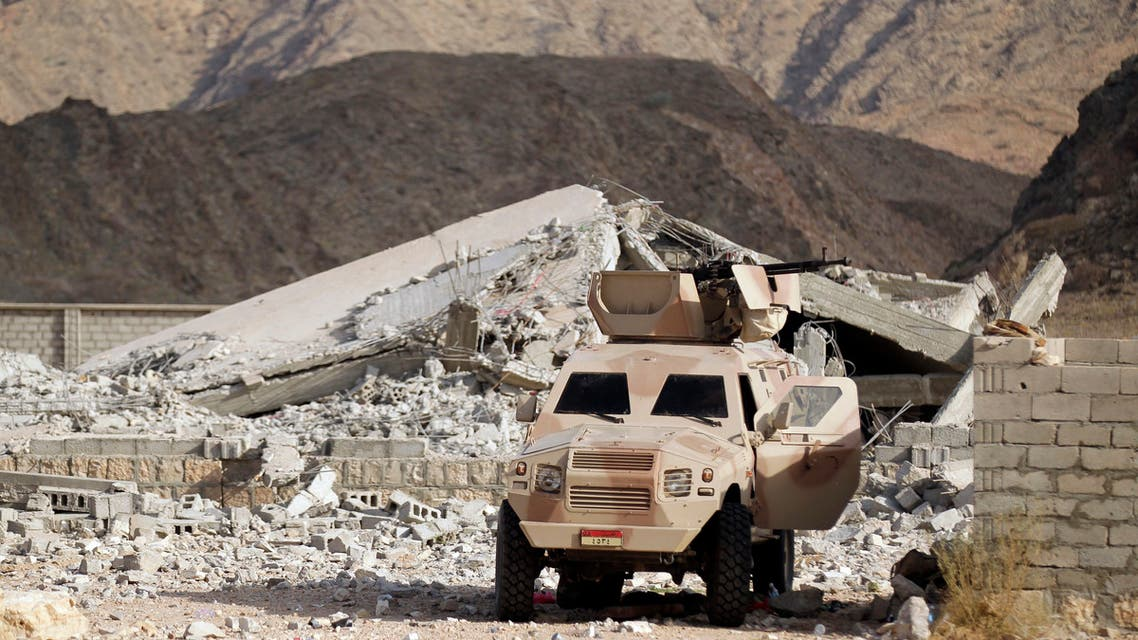 An army personnel carrier is positioned at the site of a police barracks, which was bombed by al Qaeda insurgents in al-Mahfad in the southern Yemeni province of Abyan May 23, 2014. Picture taken May 23, 2014. To match Insight YEMEN-CAMP/ REUTERS/Khaled Abdullah (YEMEN - Tags: MILITARY POLITICS CIVIL UNREST)
