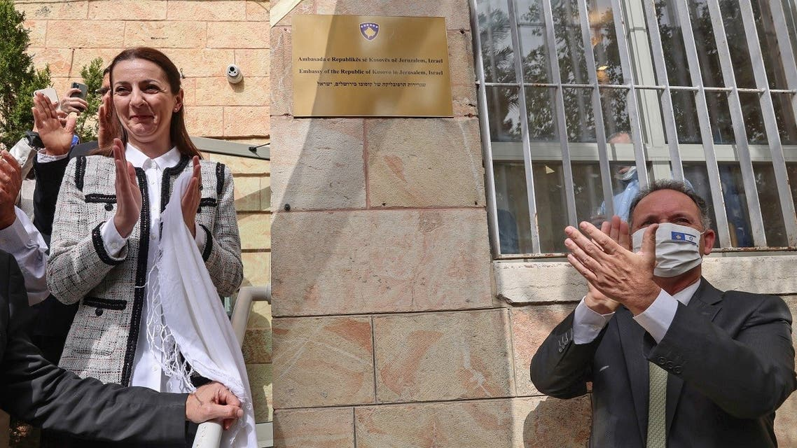 Republic of Kosovo's Ambassador Ines Demiri (L) and Gil Haskel, head of Israel's foreign ministry protocol, unveil the plate during an official ceremony for the opening of the Kosovar Embassy in Jerusalem on March 15, 2021. (Emmanuel Dunand/AFP)