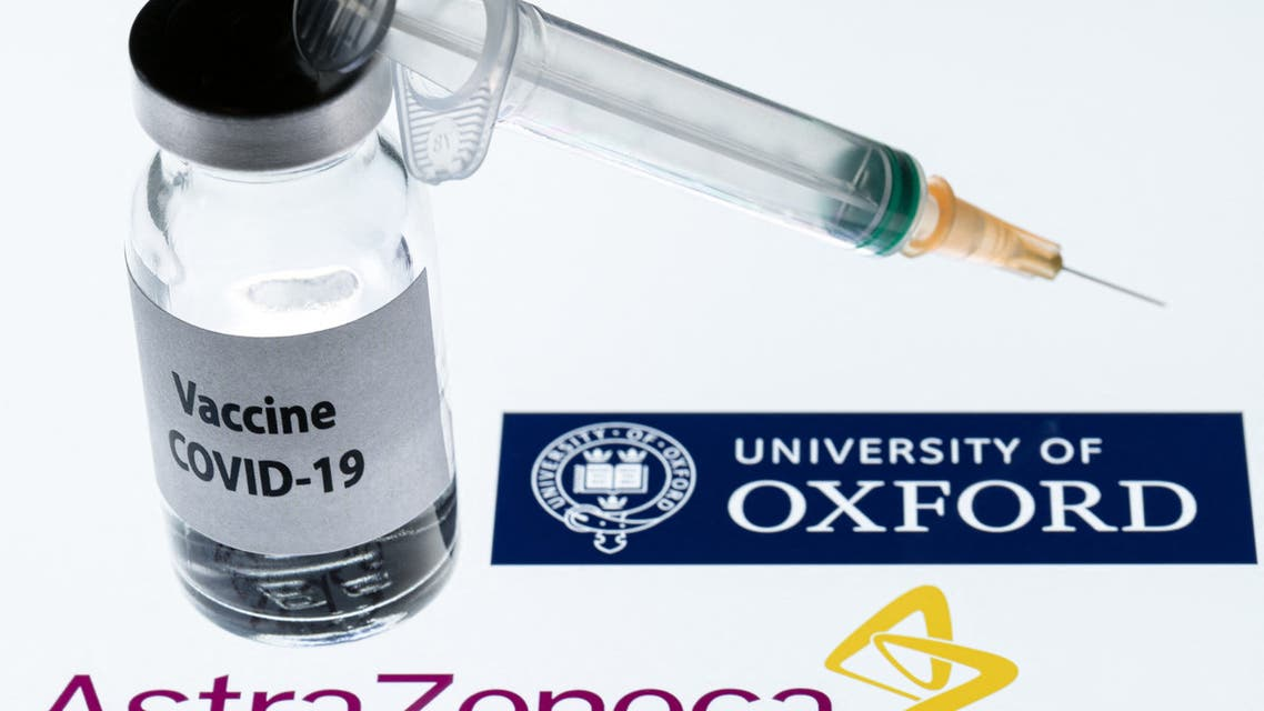 In this file photo taken on November 23, 2020 shows an illustration picture of a syringe and a bottle reading Covid-19 Vaccine next to AstraZeneca company and University of Oxford logos. (File photo: AFP)
