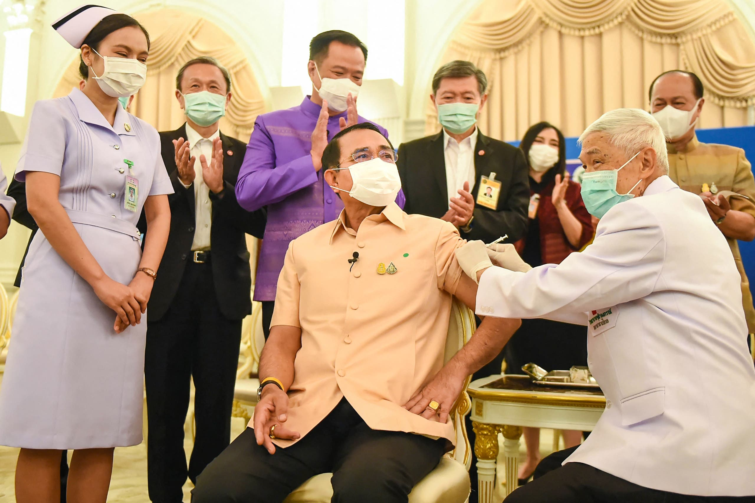 This handout from the Royal Thai Government taken and released on March 16, 2021 shows Thailand's Prime Minister Prayut Chan-O-Cha (C) receiving the Oxford/AstraZeneca Covid-19 coronavirus vaccine in Bangkok. (File photo: AFP)
