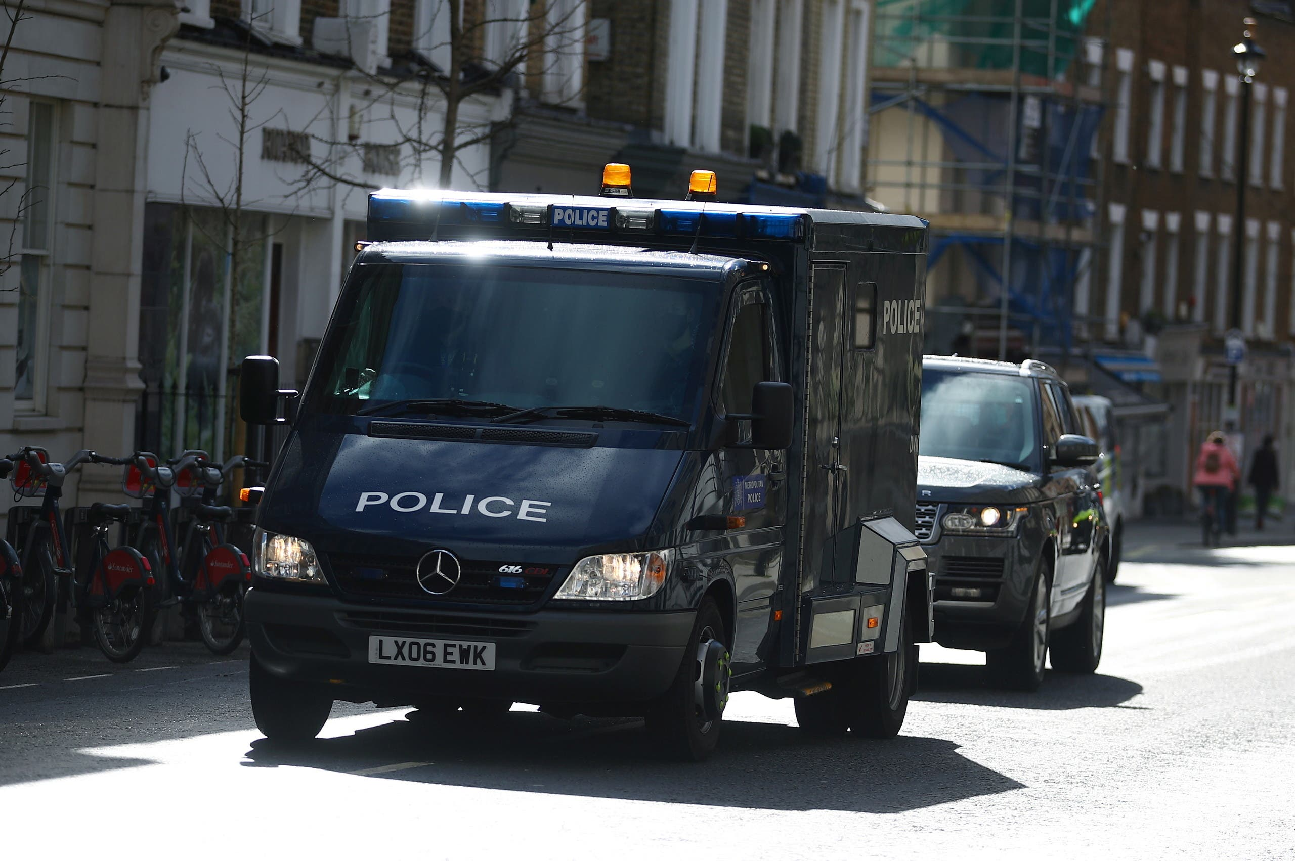 A police van believed to be carrying British Police Officer Wayne Couzens who is charged with the murder and kidnap of 33-year-old Sarah Everard arrives at Westminster Magistrates Court in London, Britain, March 13, 2021. (Reuters)