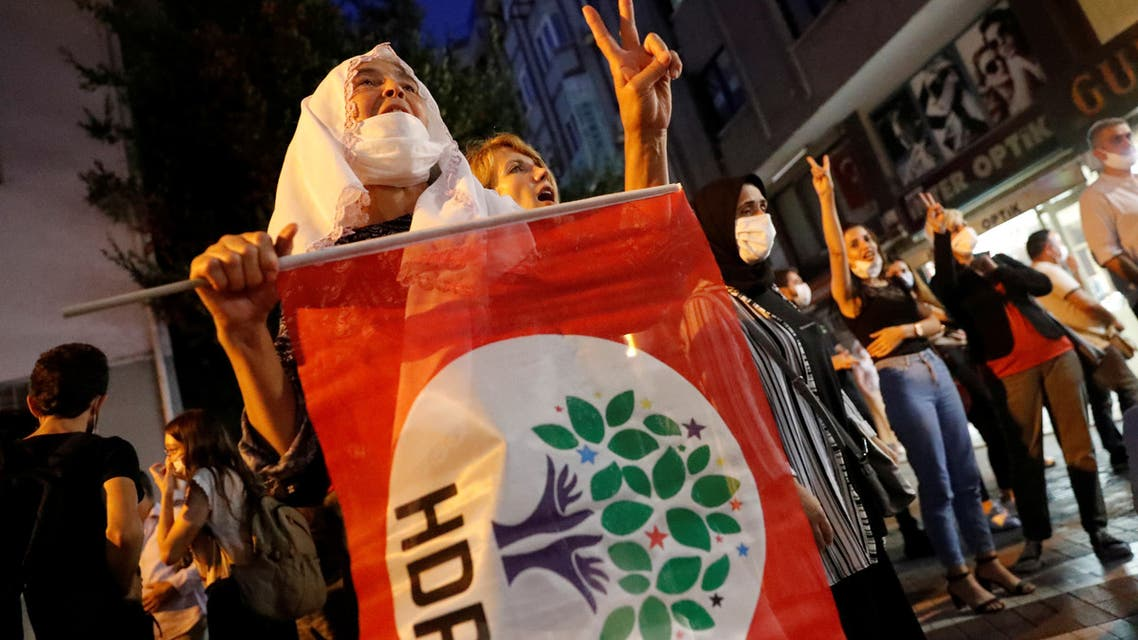 FILE PHOTO: Supporters of pro-Kurdish Peoples Democratic Party (HDP) shout slogans during a protest against the arrest of 82 people including members of their party, in Istanbul, Turkey September 25, 2020. REUTERS/Murad Sezer/File Photo