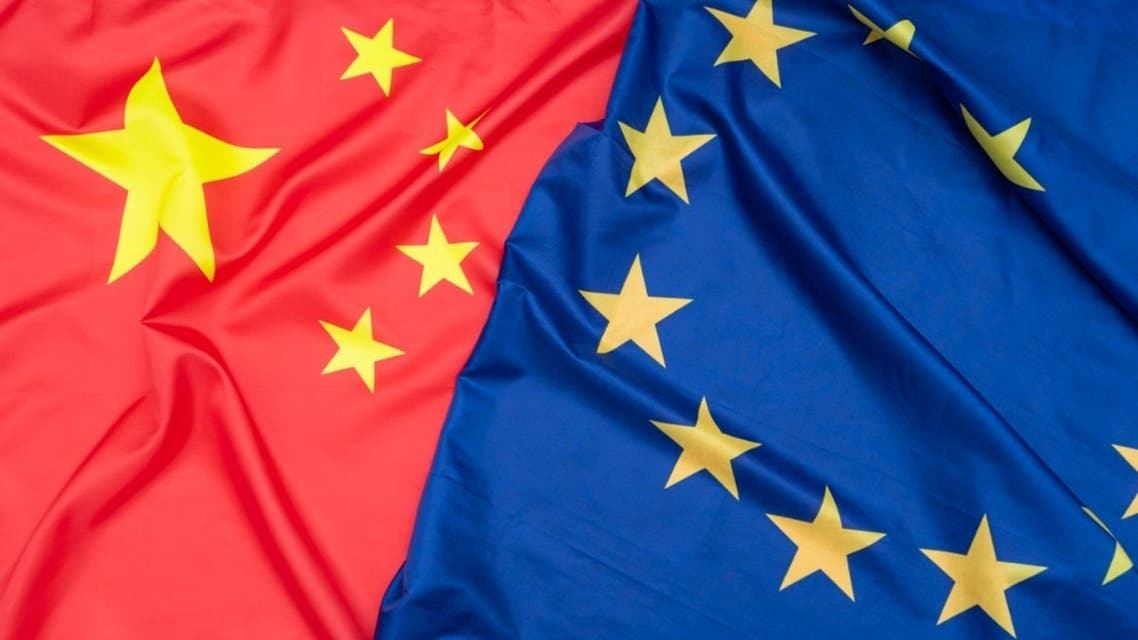 Real natural fabric flag of China or National Flag of the People's Republic of China and EU European Union flag as texture or background stock photo