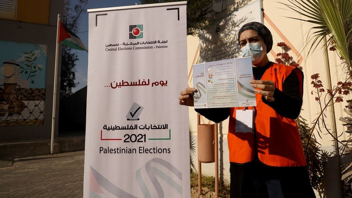 A Palestinian member of Central Elections Commission displays an information leaflet following the opening of the first Voter Information and Registration Centre in Gaza City on February 10, 2021. (Mohammed Abed/AFP)