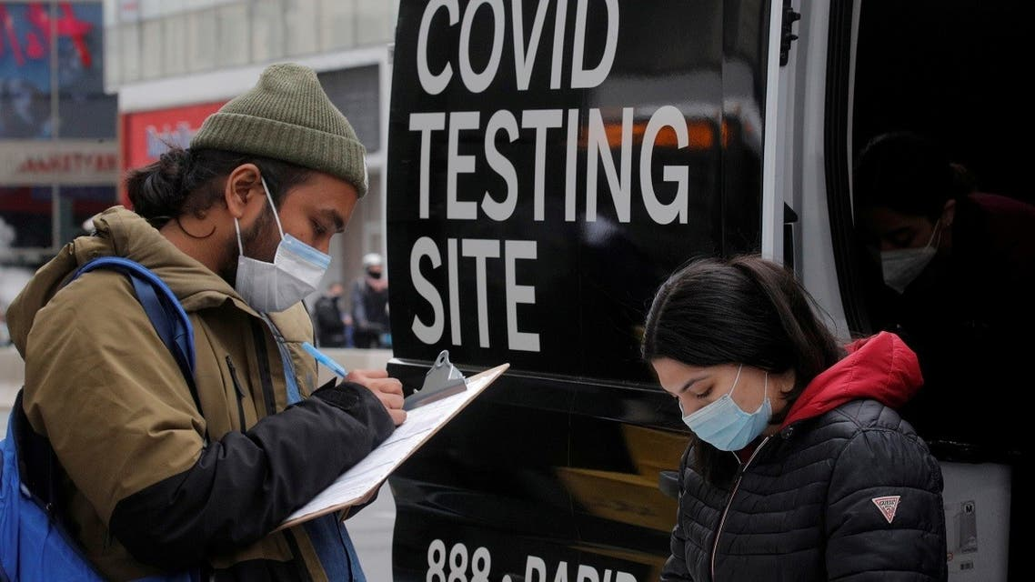 A man signs up to take a coronavirus disease (COVID-19) test at a mobile testing van in Herald Square in New York City, US, on March 16, 2021. (Reuters)