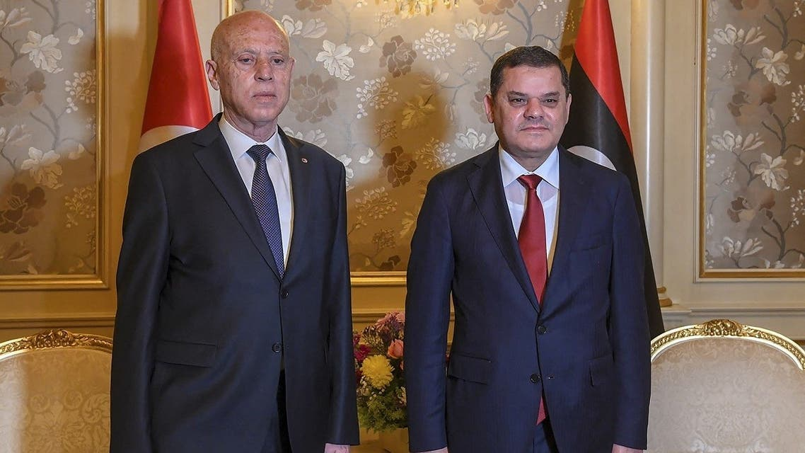 Tunisian President Kais Saied (L) meets with Libya's new interim Prime Minister Abdul Hamid Dbeibah, in the Libyan capital Tripoli, on March 17, 2021. (AFP)
