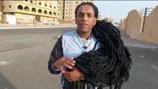 """شاب مصري ترك الدراسة والعمل ليهتم بشعره.. يسعى لدخول """"غينيس"""""""
