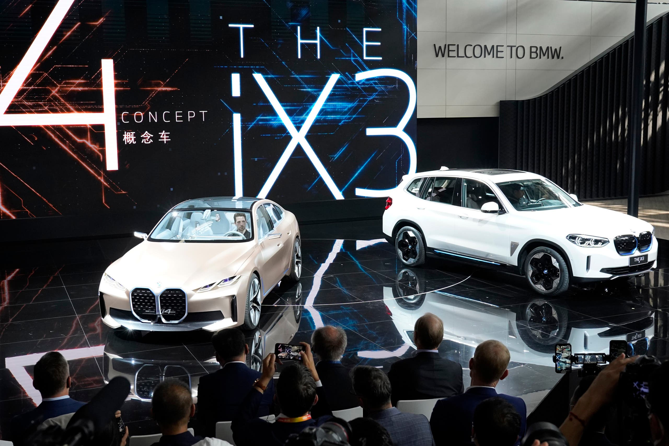 BMW displays its i4 concept car and iX3 electric SUV during the Auto China 2020 show in Beijing on Saturday, Sept. 26, 2020. (AP)