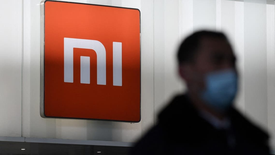 man walks past a Xiaomi store in Beijing on January 15, 2021, as shares in the company collapsed on January 15 after the United States blacklisted the smartphone giant and a host of other Chinese firms. (File photo: AFP)