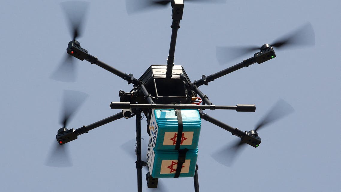 A  picture taken during a presentation to the media shows a drone flying coolers, which usually carries blood samples to be tested for Covid-19, on July 28, 2020 outside DOROT, Netanya Geriatric Medical Center, in the central Israeli city of Netanya. (File photo: AFP)
