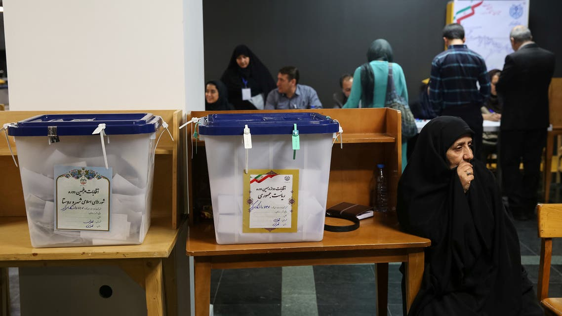 Electoral employees sits next to ballot boxes before closing vote for the presidential election in a polling station in Tehran, Iran, May 19, 2017. TIMA via REUTERS ATTENTION EDITORS - THIS IMAGE WAS PROVIDED BY A THIRD PARTY. FOR EDITORIAL USE ONLY.