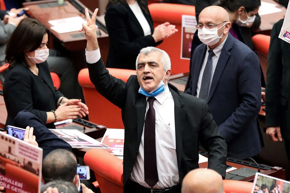 Turkish member of Parliament for the left wing political party Peoples' Democratic Party Omer Faruk Gergerlioglu (C) reacts after he was dismissed following a vote at the Turkish Parliament in Ankara, on March 17, 2021. (Adem Altan/AFP)