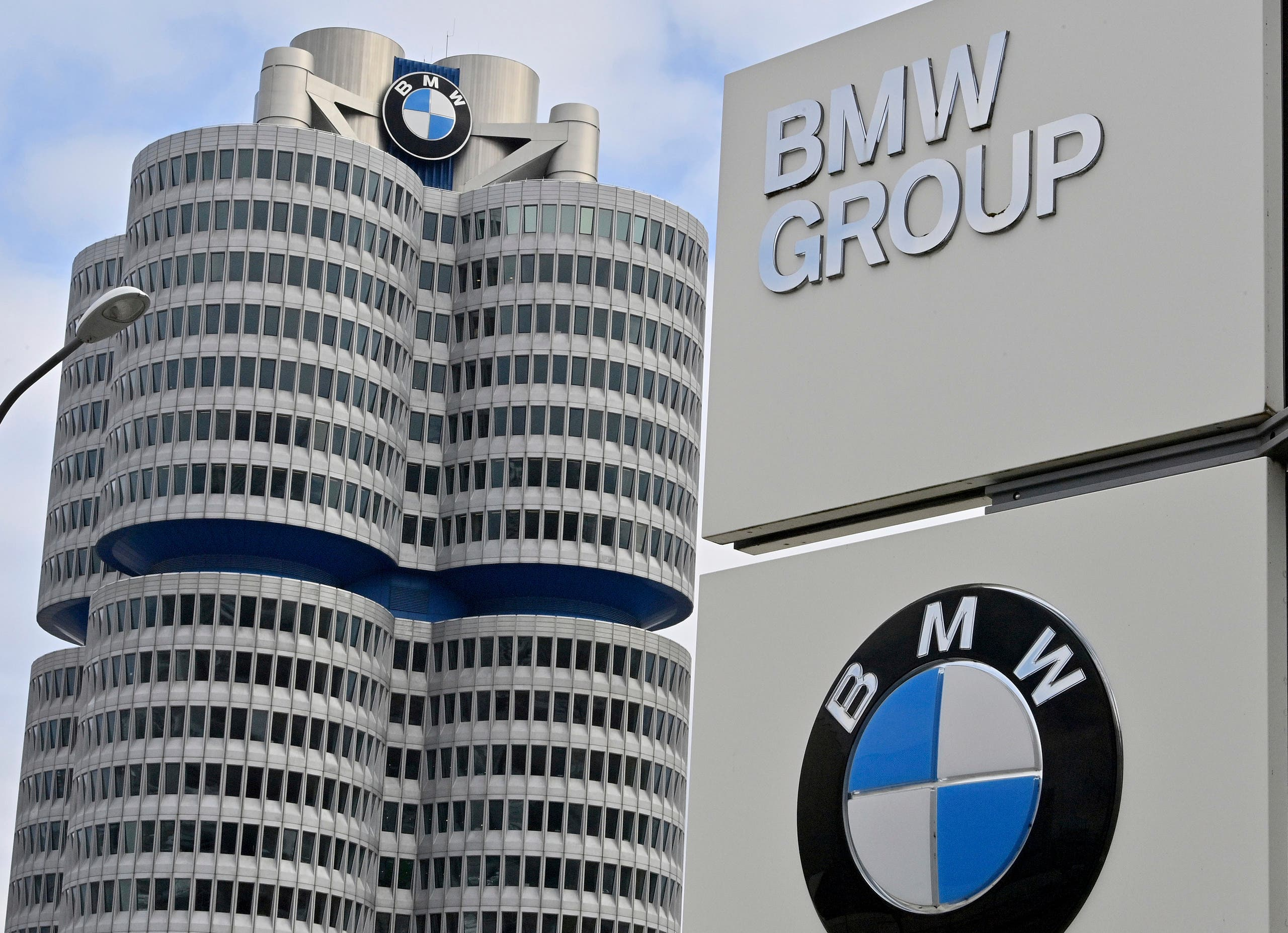 The BMW Group headquarters are pictured in Munich, Germany, Wednesday, March 16, 2021. German automaker BMW said Wednesday it intends to speed up the rollout of new electric cars, vowing to bring battery powered models to 50% of global sales by 2030. (Peter Kneffel/dpa via AP)