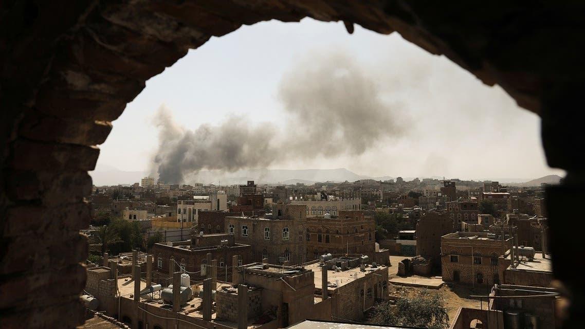 Smoke and dust rise near buildings in Sanaa, Yemen March 7, 2021. (Reuters)