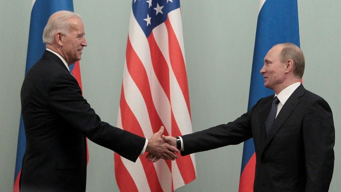 Now-Russian President Vladimir Putin (R) shakes hands with now-US President Joe Biden in Moscow March 10, 2011. (Reuters)