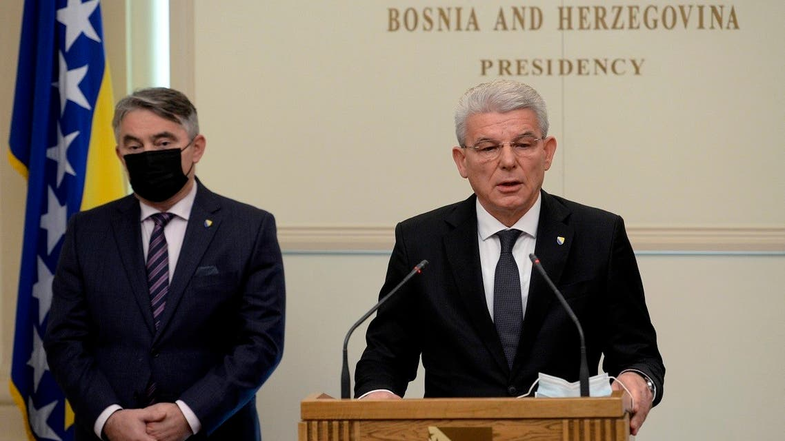 Croat member of the tripartite Presidency of Bosnia Zeljko Komsic (left), listens as Muslim member Sefik Dzaferovic make a statement after refusing to meet with Russian Foreign Minister Sergey Lavrov in the capital Sarajevo, Bosnia, on December 15, 2020. (AP)