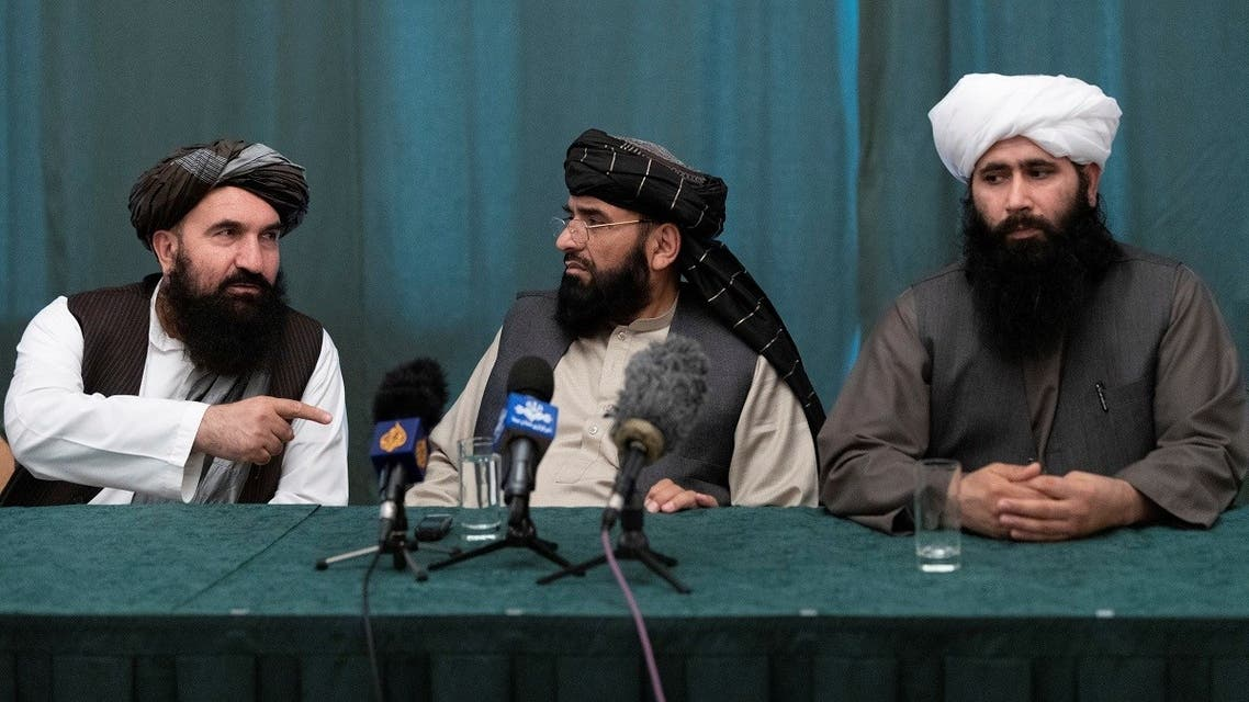 Members of the Taliban delegation: former western Herat Governor Khairullah Khairkhwa, member of the negotiation team Suhail Shaheen and spokesman for the Taliban's political office Mohammad Naeem attend a joint news conference in Moscow, Russia, on March 19, 2021. (Reuters)