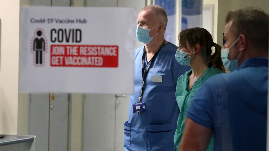 NHS staff look on as the first of two Pfizer/BioNTech COVID-19 vaccine jabs are being administered to staff, at the Western General Hospitalin Edinburgh, Scotland Britain December 8, 2020. (Andrew Milligan/Pool via Reuters)