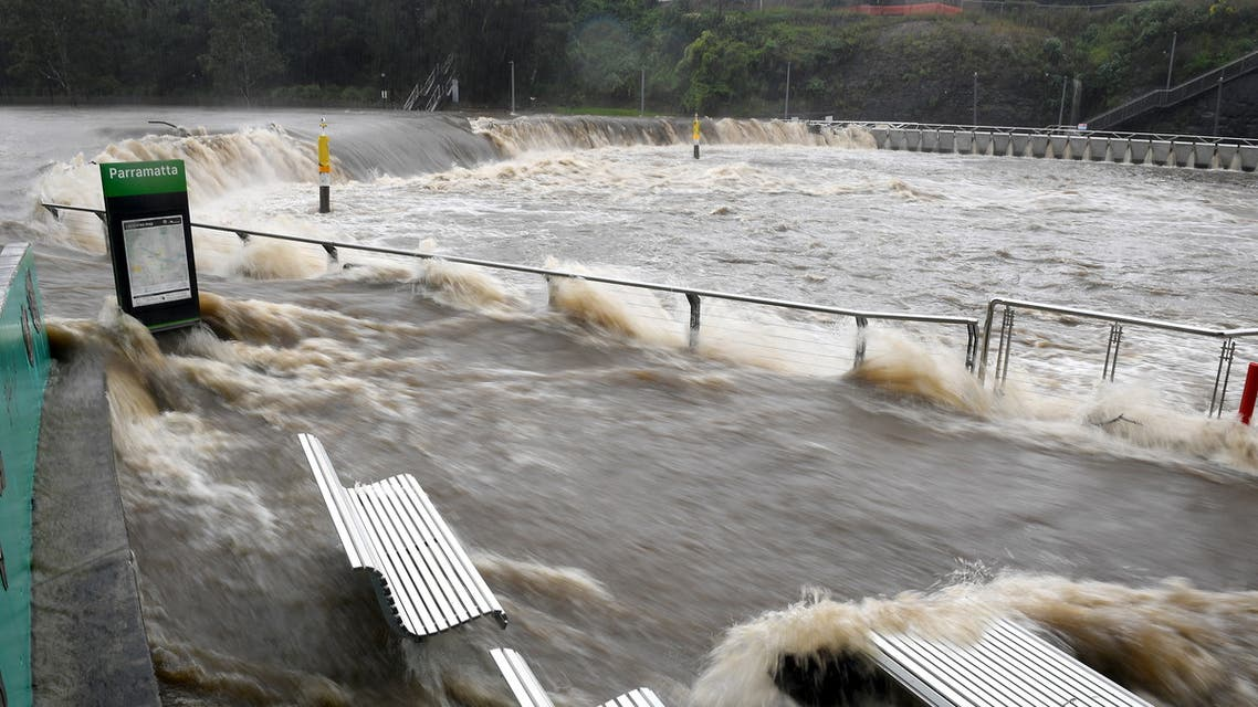 A swollen river is seen as the state of New South Wales experiences heavy rains in Sydney. (Reuters)
