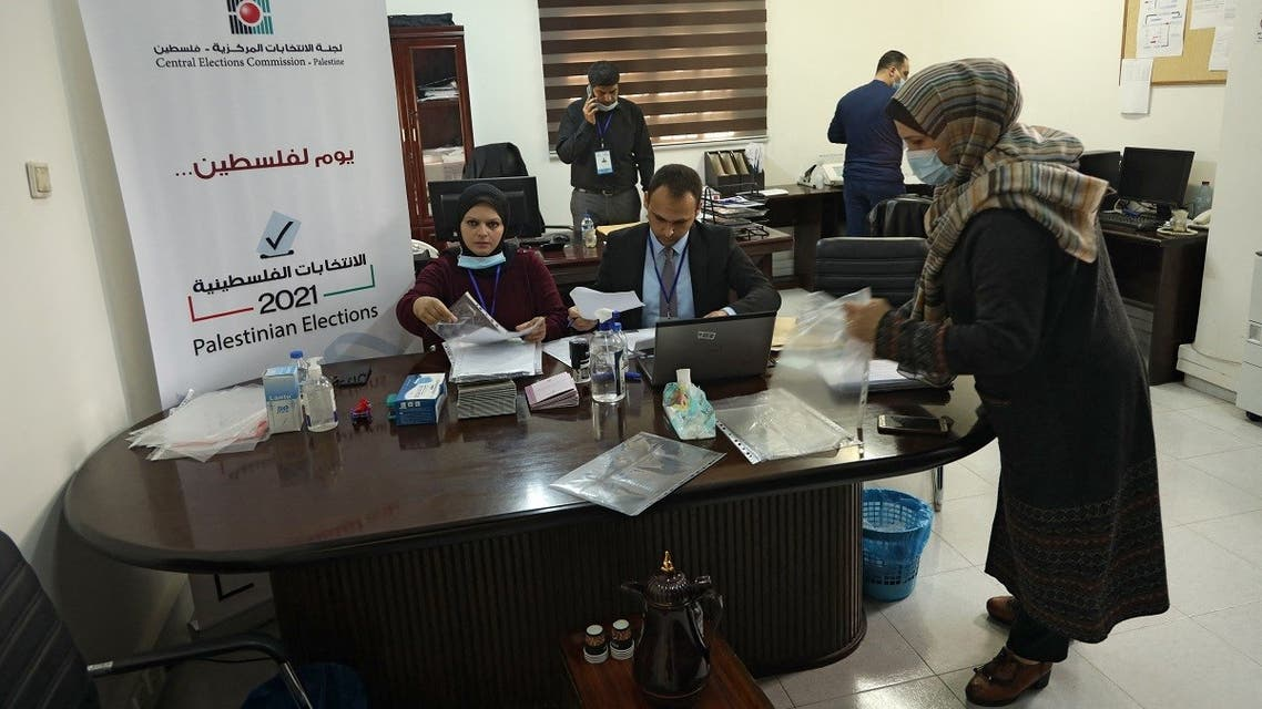 Employees of the Central Elections Commission prepare documents at the Commission's office in Gaza City on March 20, 2021, at the start of the registration period for the May parliamentary election.  (Mohammed Abed/AFP)