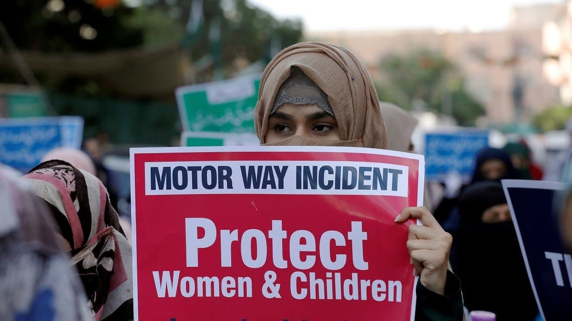 A supporter of religious and political party Jamaat-e-Islami (JI) carries a sign against a gang rape that occurred along a highway, and to condemn the violence against women and girls, during a demonstration in Karachi, Pakistan, on September 11, 2020. (Reuters)